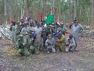 Googles on, paintball markers in hand. I say look mean, some relax, while others aim to shoot their friend in the head.