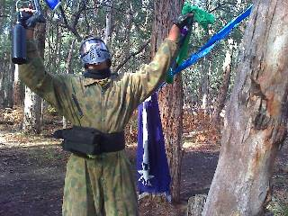 A paintball player has grabbed both flags!