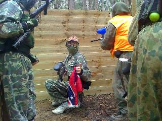 This paintball player has the flag, the medic and body guard - why wouldn't they give a thumbs up?